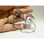 boucles doreilles anneaux entrelacés et engrenage