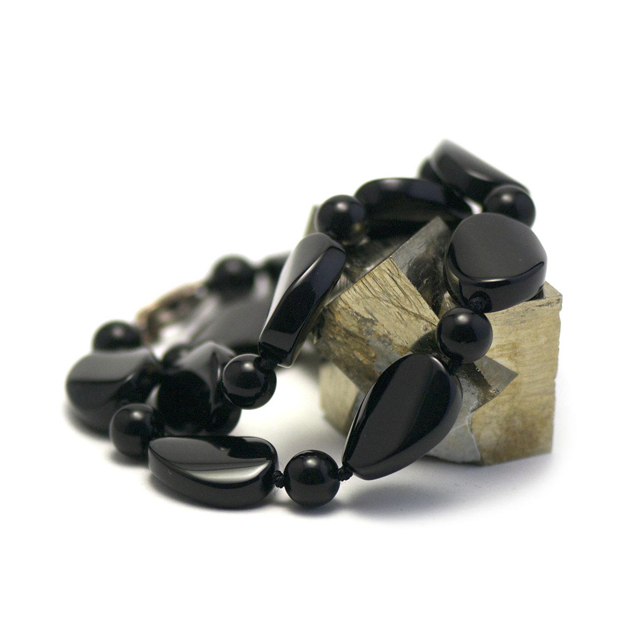collier onyx , palet oval torsadé - perle ronde 10 mm