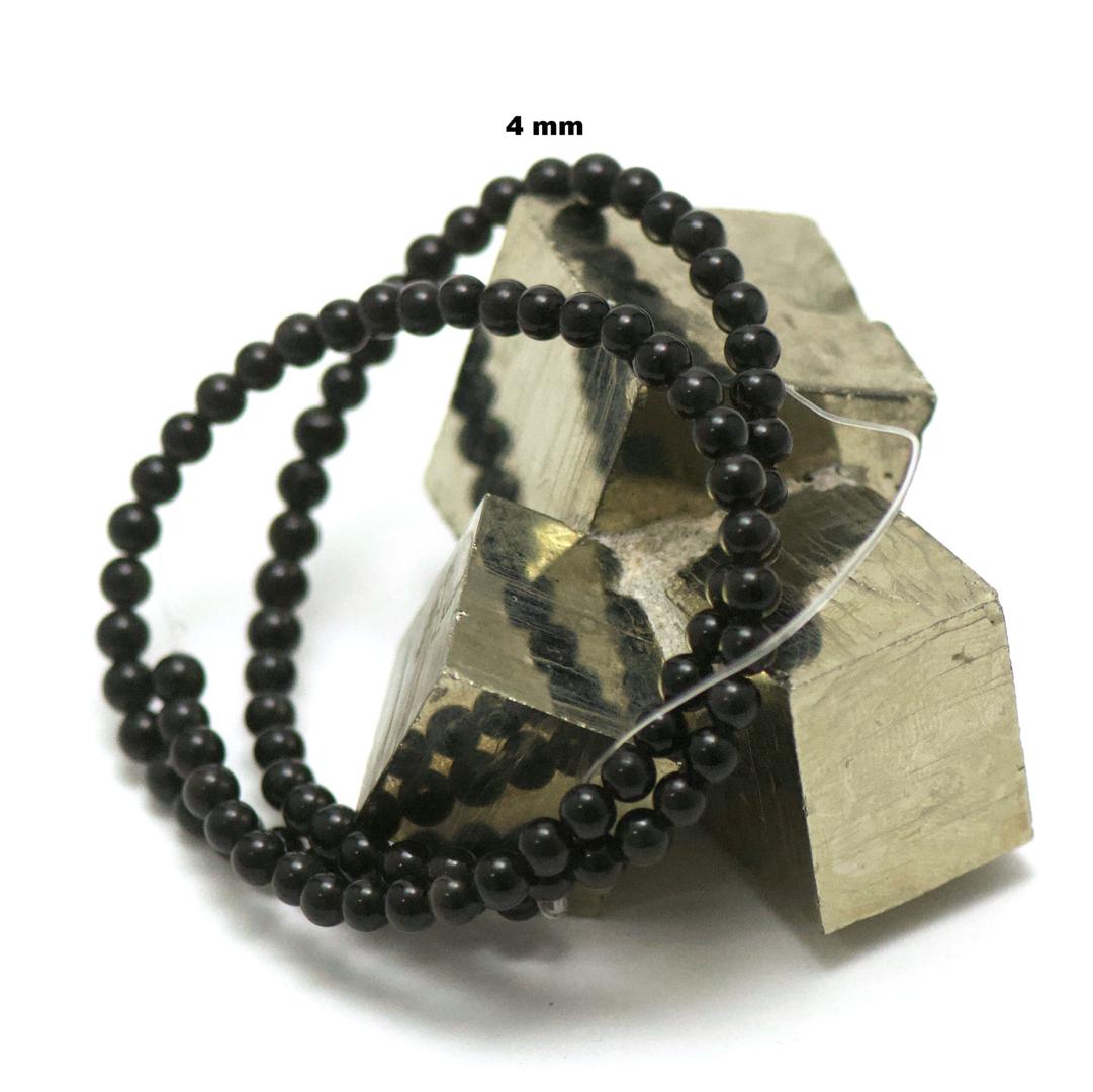 fil de 39 cm 88 perles d\'obsidienne noir ronde 4 mm