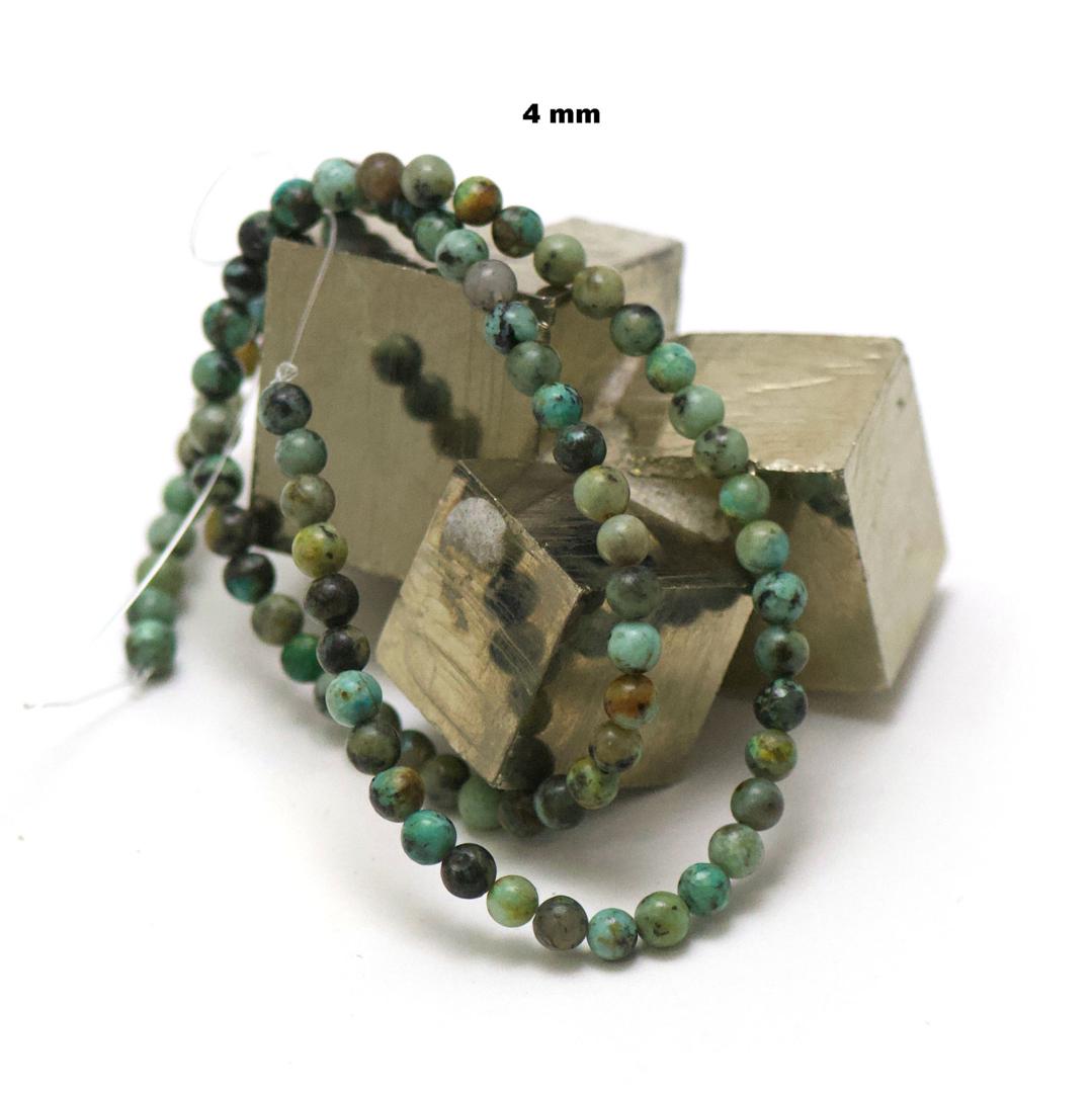 fil de 39 cm 88 perles de turquoise d\'afrique ronde 4 mm