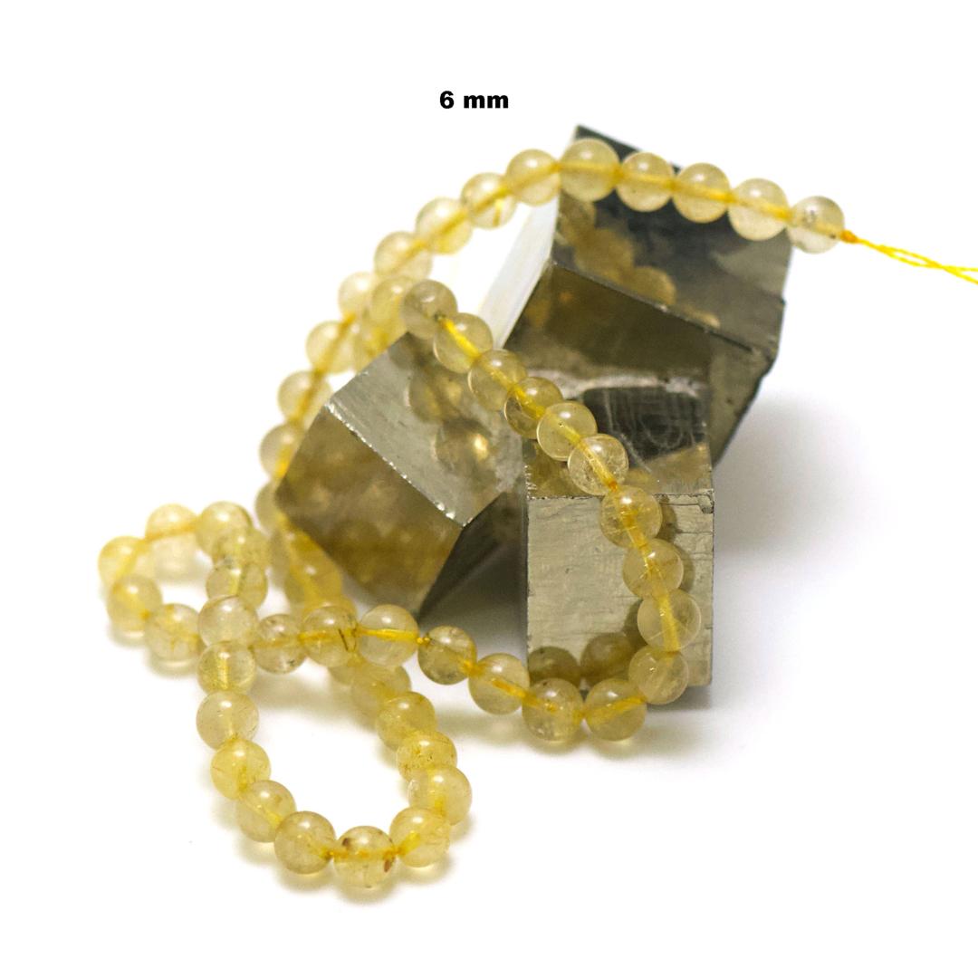 fil de 39 cm 63 perles de quartz rutile ronde 6 mm