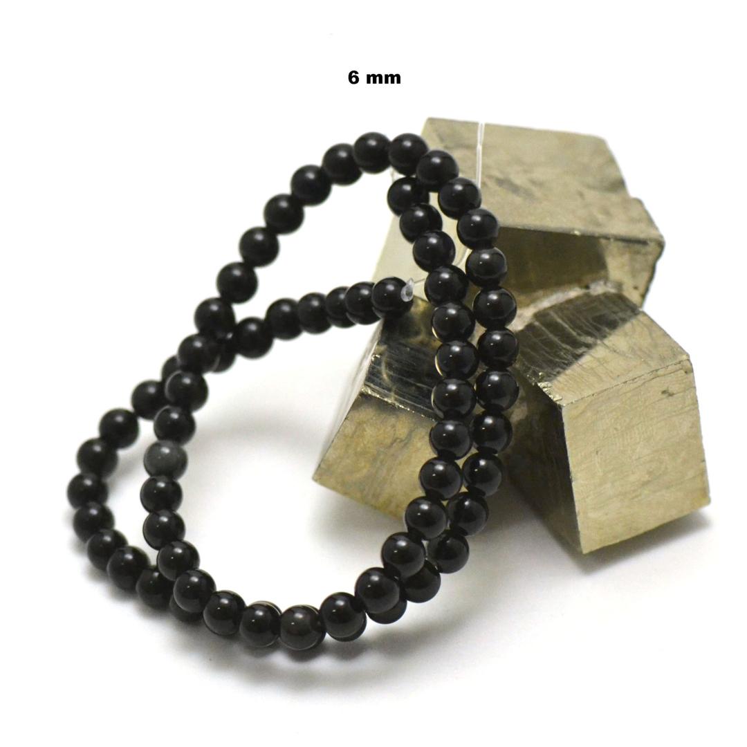 fil de 39 cm 63 perles d\'obsidienne noir ronde 6 mm