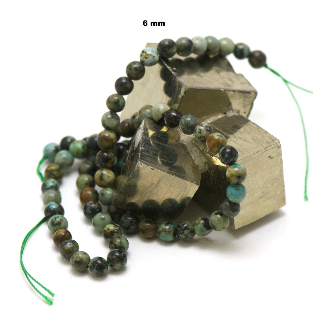 fil de 39 cm 63 perles de turquoise d\'Afrique ronde 6 mm