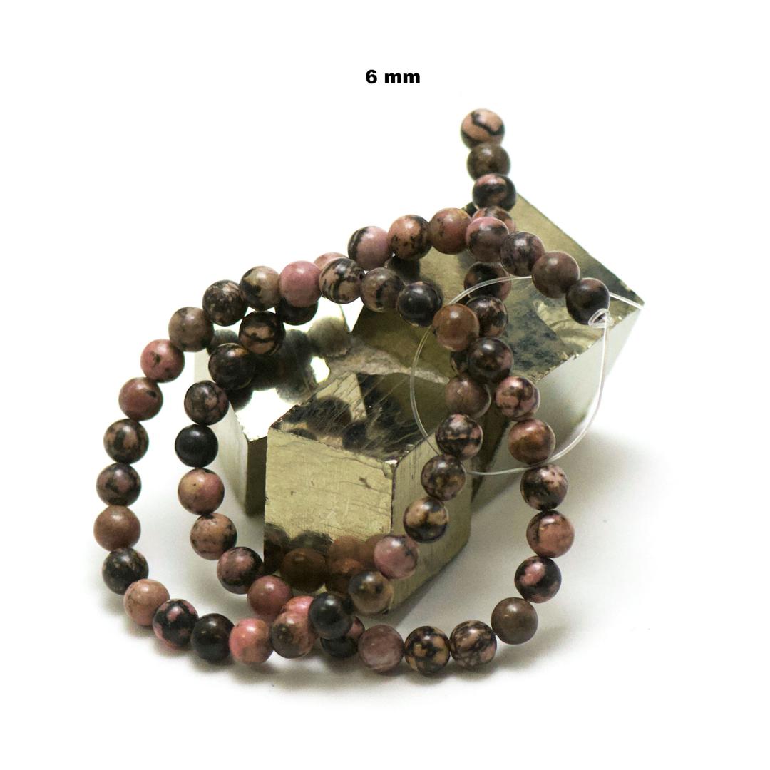 fil de 39 cm 63 perles de rhodonite de Madagascar ronde 6 mm