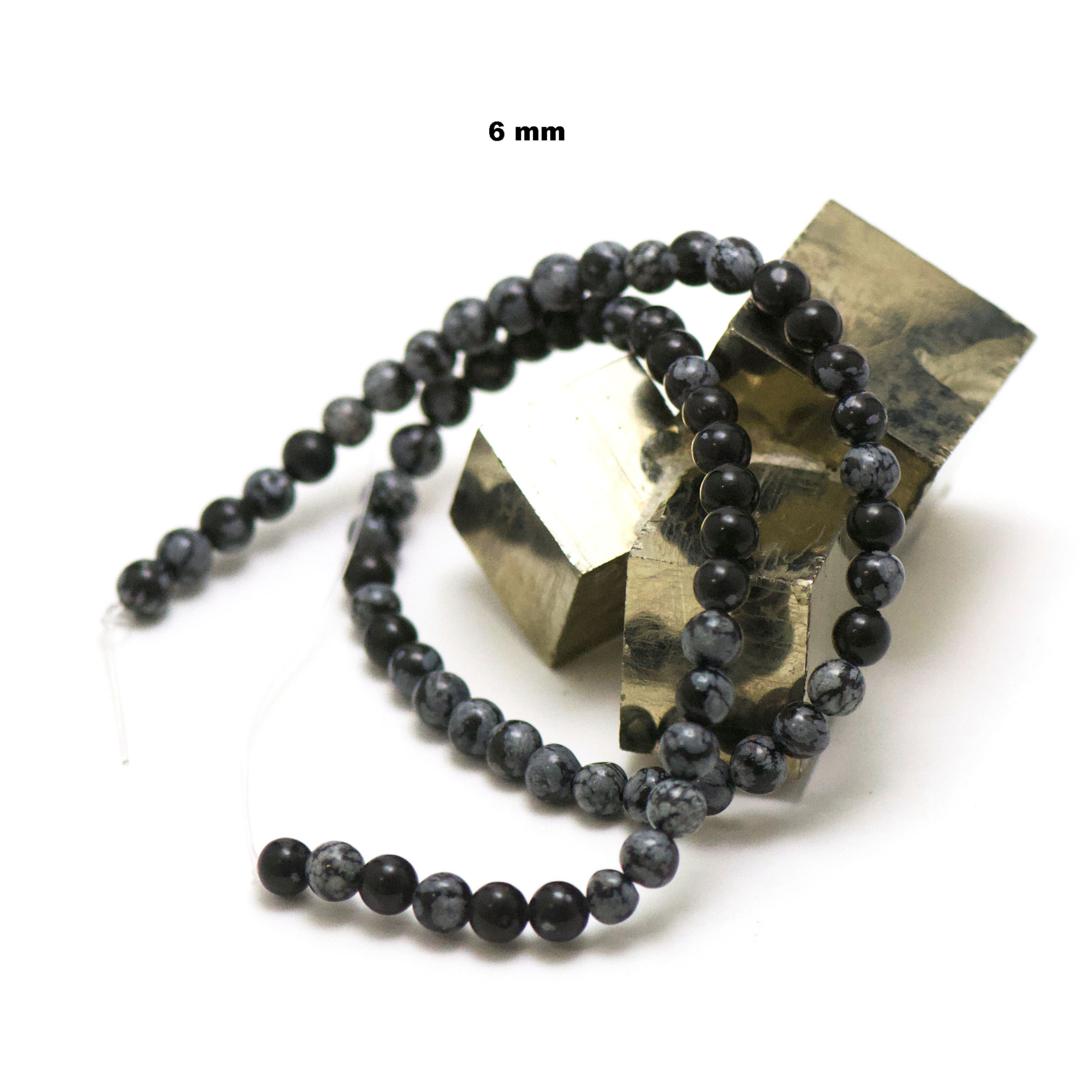 fil de 39 cm 63 perles d\'obsidienne neige ronde 6 mm
