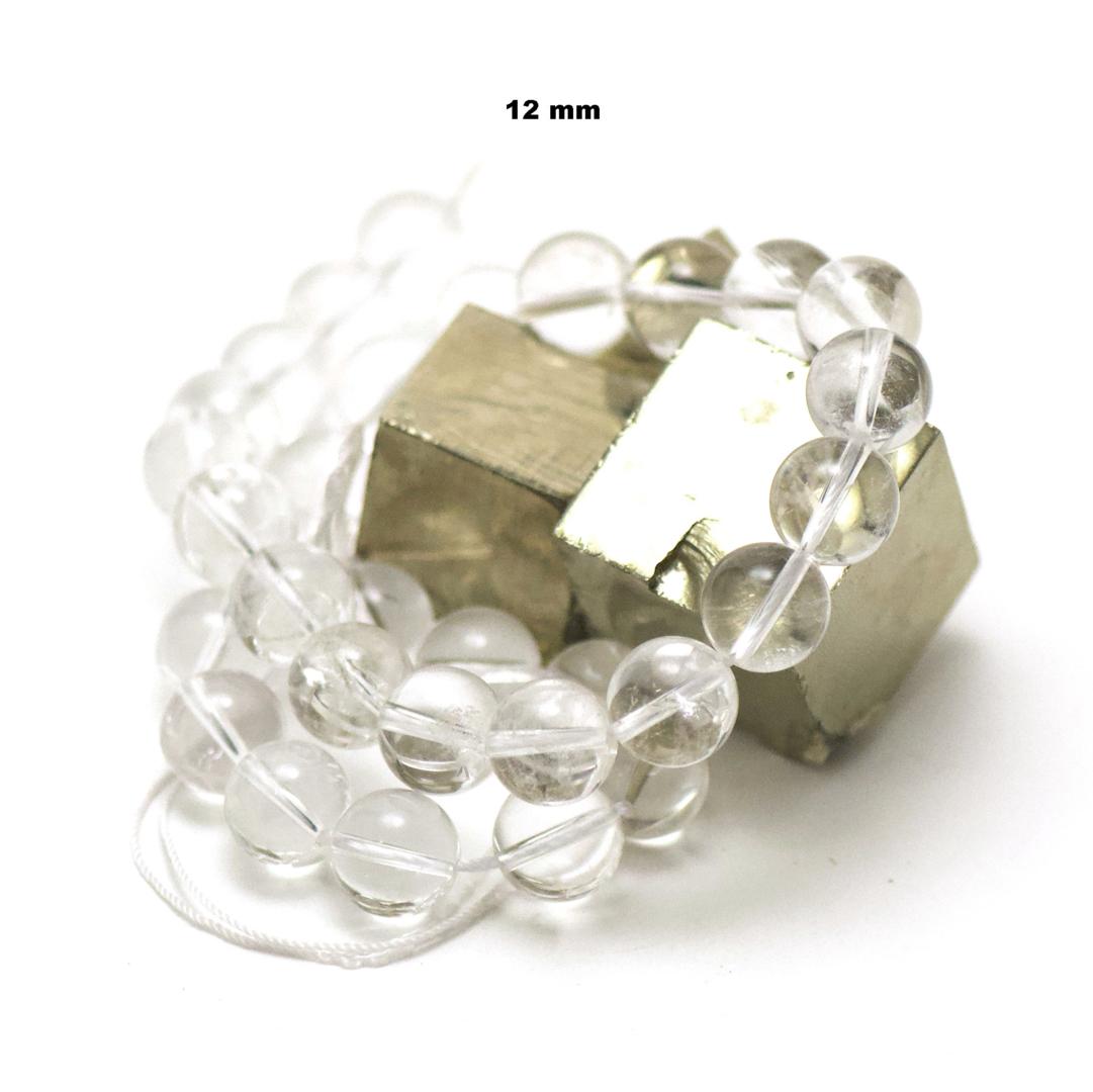 fil de 39 cm env 32 perles de cristal de roche ronde 12 mm