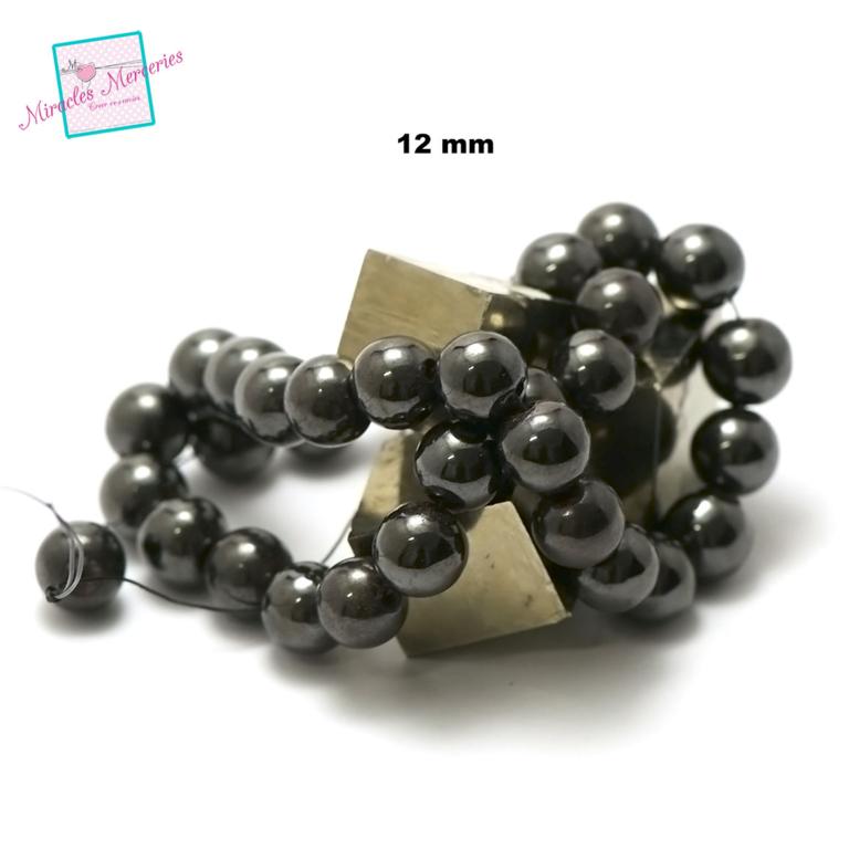 fil de 39 cm env 32 perles d\'hématite ronde 12 mm
