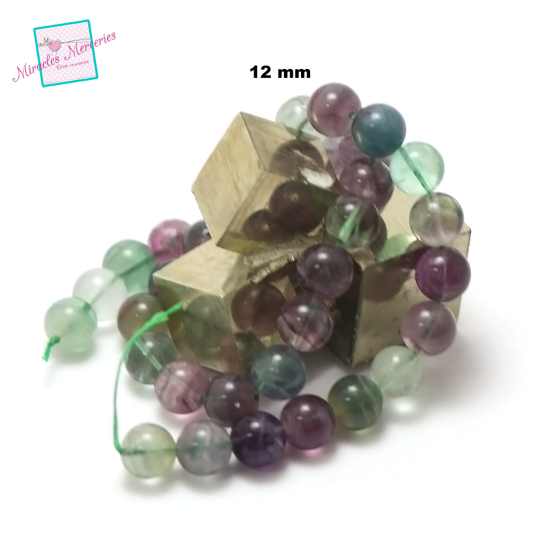 fil de 39 cm env 32 perles de fluorite ronde 12 mm