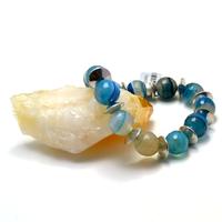 """Bracelet agate teintée bleu """" ronde facettée 12 mm- métal argenté"""""""