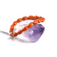 bracelet en corail naturelle /bambou de mer  , olive orangé