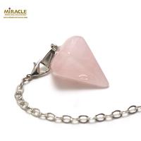 "pendule en quartz rose "" grande cône facettée"""