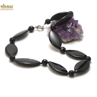 "Collier onyx, ""palet oval /ronde facettée 10 mm"""