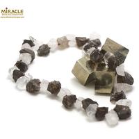 """collier quartz fumé/cristal de roche ,perle """"galet rondelle brut"""""""