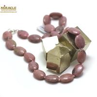 "collier rhodonite, perle ""palet ovale"""