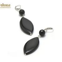 """boucle d'oreille onyx, perle """"palet oval-ronde 10 mm facettée"""""""