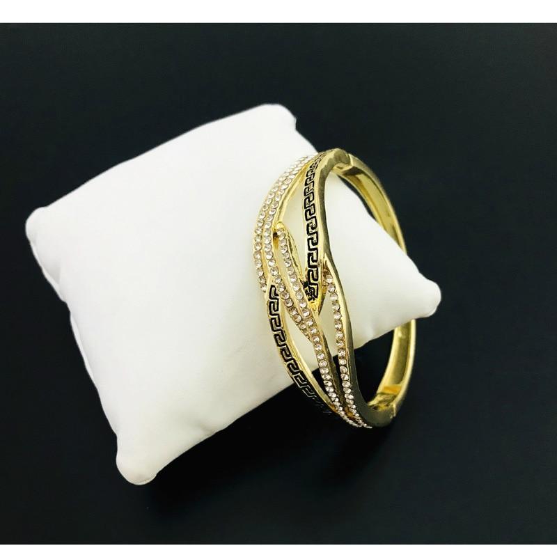 Bracelet manchette ethnique doré avec strass