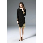 Robe noire en broderie dorée