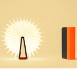 LUMIO mini lampe livre noir orange posé ouvert 360° cosmo