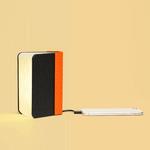 LUMIO mini lampe livre noir orange posé ouvert batterie portable