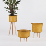 UP collection handed by cachepots jaune moutarde sur pied en bois 3 tailles
