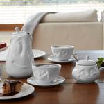 sucrier visage doux cafetière et tasses à café en porcelaine de Tassen sur table à manger gouter
