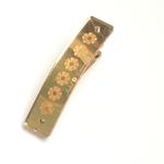 barrette glossy or clistal à fleurs