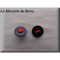 Bouton point rouge sur fond noir