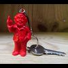 Porte clef, le fameux nain doigt d'honneur de Ottmar Hörl, Rouge