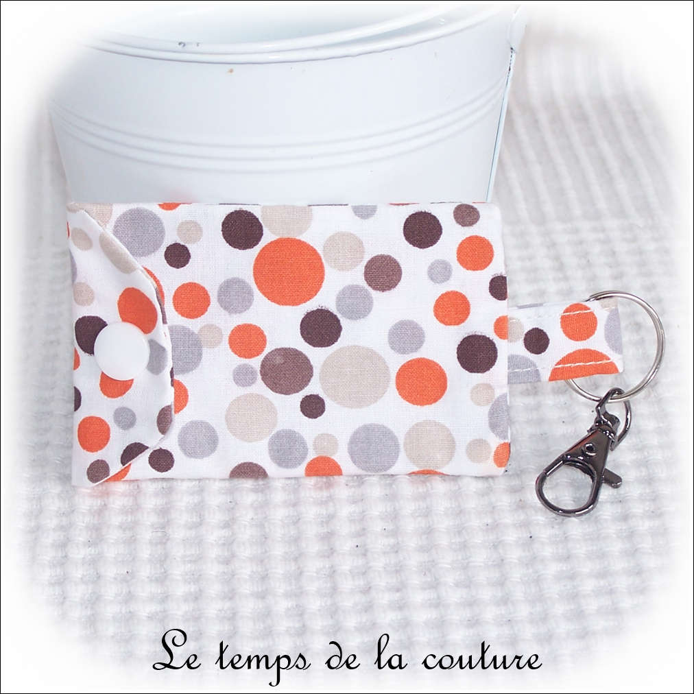 Pochette porte clé motif à pois tons orange taupe gris