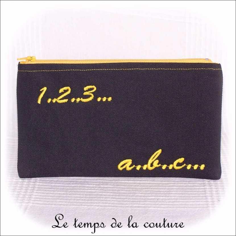 Trousse plate motifs lettres et chiffres tons noir et jaune