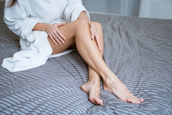 beautiful-well-groomed-feet-on-the-bed-foot-skin-care-concept-at-home