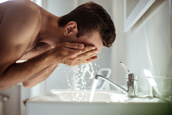 handsome-young-naked-man-is-washing-his-face-bathroom-home