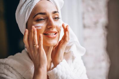 woman-applying-face-cream