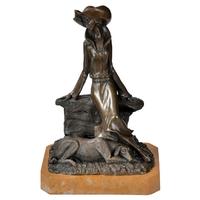 Statue en bronze 29 cm femme avec son chien