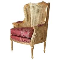 Bergère style Louis XVI en bois doré canné et tissu rouge Maurepas