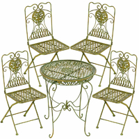 4 chaises et 1 table en fer forgé vert