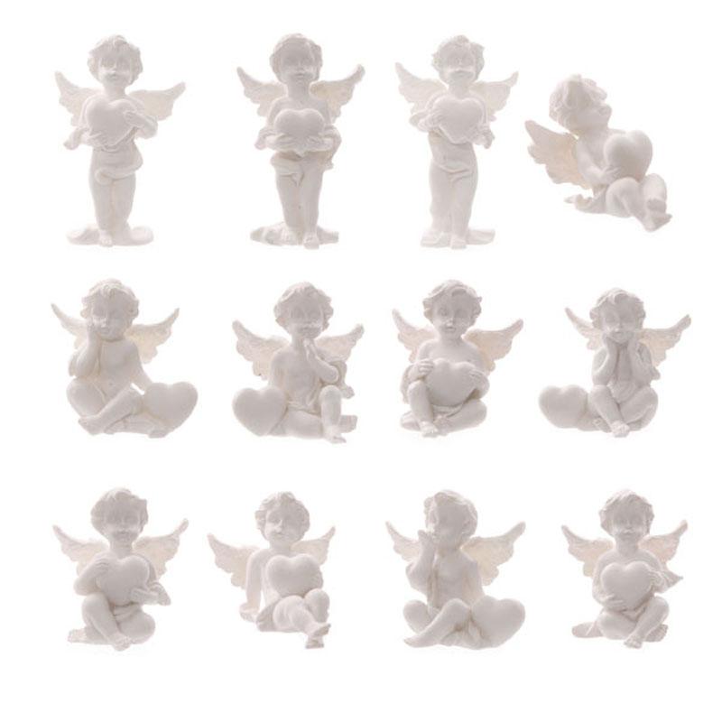 Figurines du monde des Chérubins avec c?ur