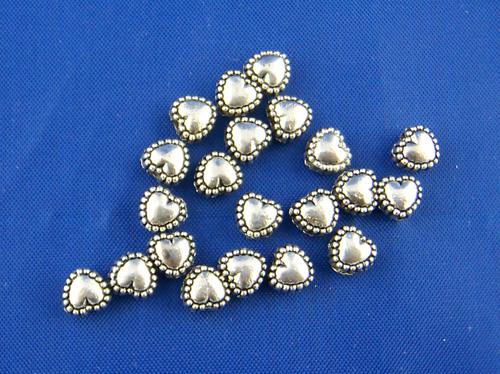Lot de 20 perles coeurs 5x6x4mm métal argenté