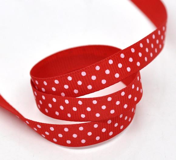 Un mètre de  Ruban rouge à pois blanc en polyester 10mm