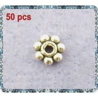 Lot de 50 Perles étoiles métal argenté 4mm