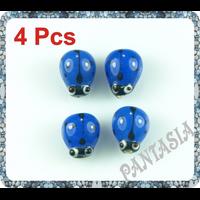 Lot de 4 perles coccinelle en verre lampwork  bleu