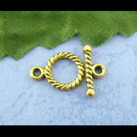 Lot de 7 fermoirs toggle métal doré 10x14mm