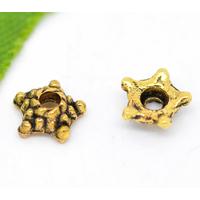Lot de 50 Coupelles fleur 5mm en métal doré