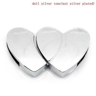 Un fermoir aimanté forme coeur magnétique métal argenté 31x18mm