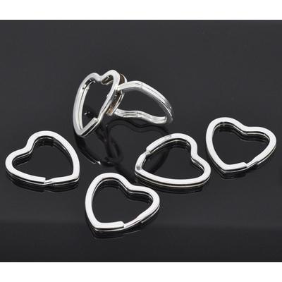 Un anneau  Porte-clés Coeur métal  Argenté 31x31mm