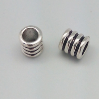Perle métal coloris argent tibétain