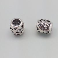Perle en métal coloris argent tibétain