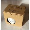 HISTOIRE-DAVANT-mug-avec-son-couvercle-en-liège-et-sa-boite-carton-serigraphiee-marcel-&-lily