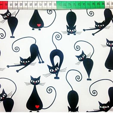 Chats de coton noir sur fond blanc