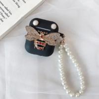"Coque AirPods ""Abeille"" diamant perle noir"